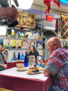 Andrew Zimmern enjoying typical food from Argentina